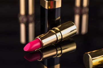 Lipstick. Fashion Colorful Lipsticks over black background. Professional Makeup and Beauty. Beautiful Make-up concept. Lipgloss. Lipsticks closeup