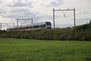 Train type SLT light rail of the NS running at the railroad track in Nieuwerkerk aan den IJssel in the Netherlands.