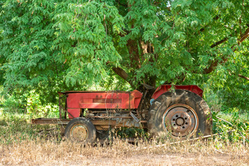 Old tractor in countryside.