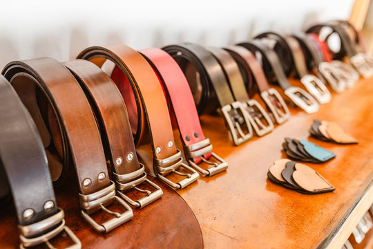 Handmade Leather Belts for sale in a stand of the crafts market
