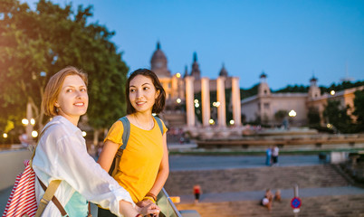 Two Girl friends tourists in National Art Museum of Catalonia at evening time