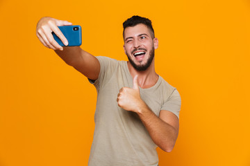 Portrait of a cheerful young bearded man in t-shirt