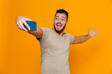Portrait of a happy young bearded man in t-shirt