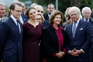 Sweden's Crown Princess Victoria and Prince Daniel, Sweden's King Carl XVI Gustaf and Queen Silvia attend a ceremony at the Parc Beaumont as part of a visit for the bicentenary of the Swedish throne in Pau