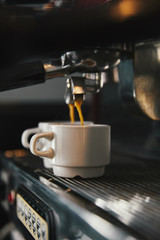 close-up view of coffee machine and two cups with espresso