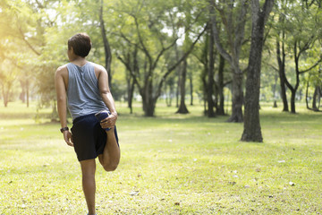 Sporty man jogging or exercise in national park on early morning .Sport concept.