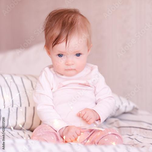 Cute Baby Girl Sitting In Bed Wearing Pajamas Closeup Good Morning
