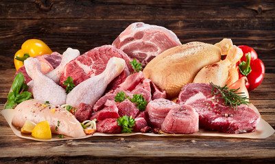 Raw meat assortment on cooking paper Wall mural