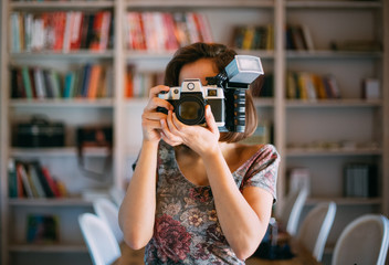 Woman Taking Pictures with Retro Camera