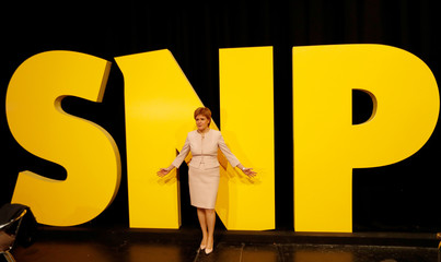 Scotland's First Minister Nicola Sturgeon poses for pictures at the Scottish National Party's party's conference in Glasgow