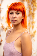 Funny young woman with orange hair
