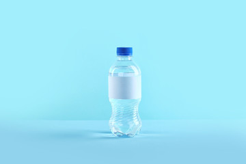 Plastic bottle of pure water with blank tag on color background