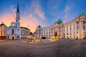 Self adhesive Wall Murals Vienna Vienna, Austria. Cityscape image of Vienna, Austria with St. Michael's Church and located at St. Michael Square during sunrise.