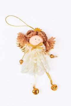 Cute Christmas angel figurine, white background. Vintage Christmas white and gold angel decoration isolated on white background. Christmas holiday concept.