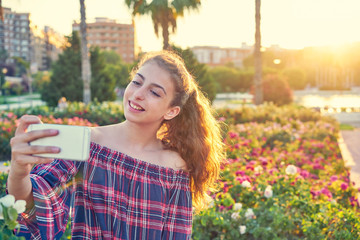 Teen girl selfie photograph in a city park