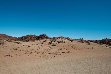 desert landscape -  sand, rocks and clear blue sky copy space
