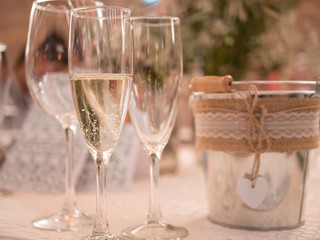 Three glasses with romantic cube in wedding celebration