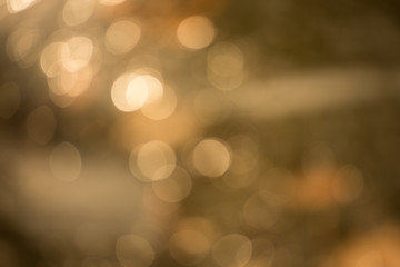 Abstract blurred golden background with round bokeh, photo