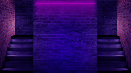 Background of an empty staircase, a brick wall, neon light, rays, smoke.