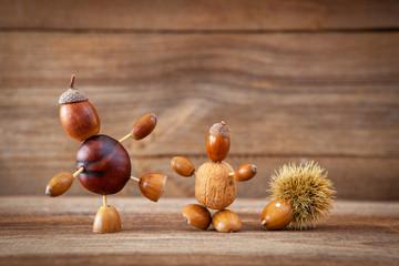 autumn tinker figures on wooden background