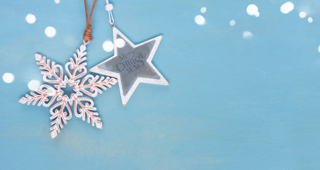 Blue and white christmas with stars on blue wooden background banner