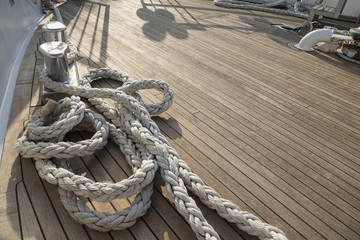 Yacht's bow covered with teak wood background.