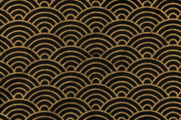 Highly detailed all over background texture of traditional japanese black and gold rainbow-shaped pattern design textile in synthetic fabric.