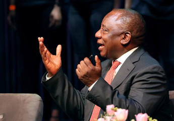 President Cyril Ramaphosa gestures before delivering the 8th Desmond Tutu International Peace Lecture in Cape Town