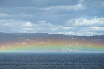 Rainbow just above the water.