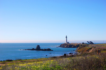 Lighthouse with blue sky background in Pigeon Point Light Station State Historic Park, Pescadero, California, USA