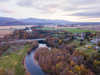 Aerial of the small town of Elkton, Virginia in the Shenandoah Valley with Mountains in the Distance