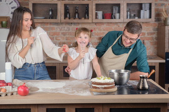 Happy Family Singing In The Kitchen After Cooking Dinner Stock Photo Adobe Stock