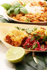 various street food with chicken wings on rustic background. balinese nasi campur and indian and brasilian street food.