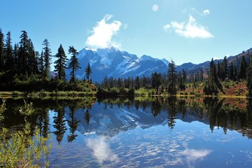 Stunning view of Mount Shuksan and its reflection in Picture Lake on a tranquil morning in September
