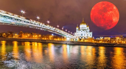 Moon collage of wide angle night view of famous illuminated orthodox church