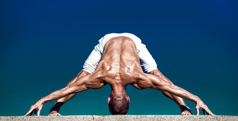 Yoga is the best holistic workout. Mental and physical health. Muscular man in yoga position. Yoga instructor with muscular body do sport. Sport and health care. Success is dependent on effort
