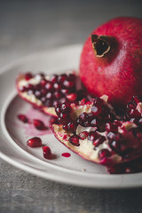 Close-up of pomegranate seeds in plate on table