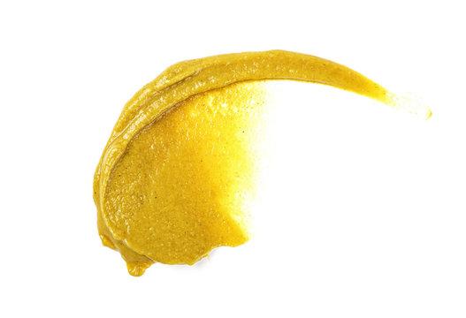 Mustard sauce. Splash of mustard on a white background.