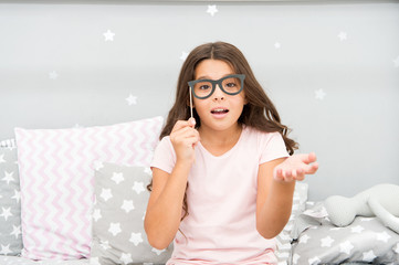 Slumber party photo booth props. Kid girl wondering posing with vintage eyeglasses party attribute. Prepare photo booth props hand made or buy for party. Printable photo booth props pajama party