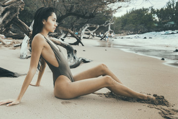 Woman sitting at beach, Kailua Kona, Hawaii, USA
