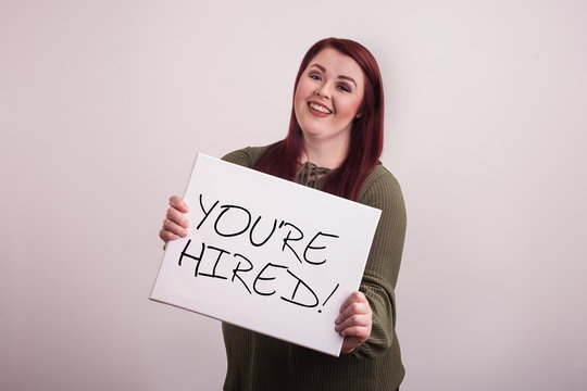 You're Hired board held by young college student