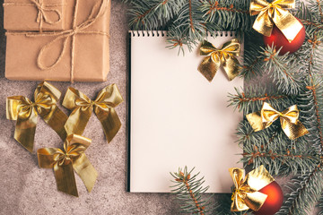 Scratchpad  for wishes with Christmas decorations on slate bacground