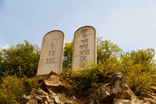 Ten Commandments List. Stone tablets on a rocky hill with carved 10 commandments.