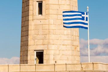 Lighthouse near Gythio against blue sky