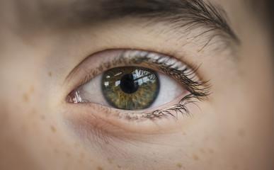 Extreme close-up portrait of boy with hazel eye
