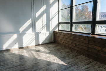 empty room with white walls and light from the window