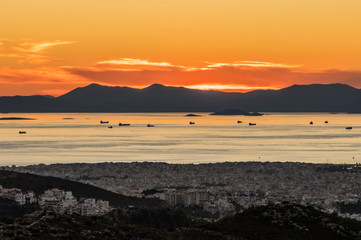 Sunset view of ships in Piraeus port, Athens in Greece
