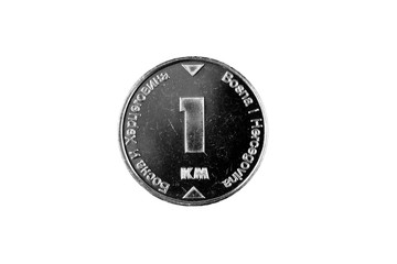 A macro image of a Bosnian 1 convertible mark coin isolated on a white background