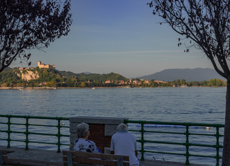 the beautiful Lombard shore of Lake Maggiore seen from the lakefront of Arona, Piedmont. Italy