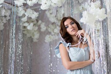 Beautiful young woman in silver studio